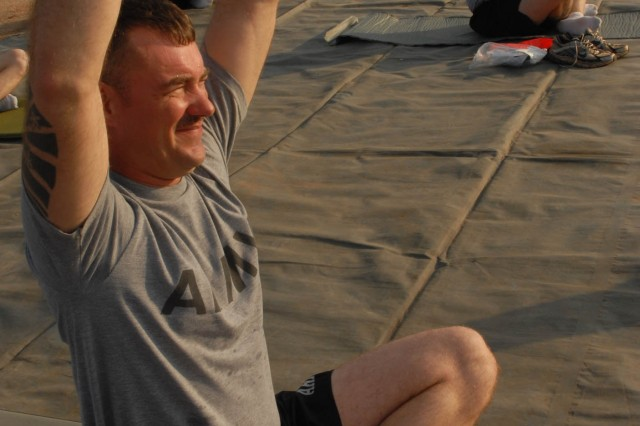 "CAMP BUNDELA, India- (Oct. 11, 2009) - Sgt. Bradley Jackson, joins other Soldiers assigned to Troop B, 2nd Squadron, 14th Cavalry Regiment, ""Strykehorse,"" 2nd Stryker Brigade Combat Team, 25th Infantry Division, in a yoga session at Camp Bundela in Babina, India, Oct. 11. The instruction is part of a cultural exchange between the Indian Army and the U.S. Army. The Soldiers are in India in support of Exercise Yudh Abhyas 09. YA09, which is scheduled for Oct. 12-27, is a bilateral exercise involving the Armies of India and the United States. The primary goal of the exercise is to develop and expand upon the relationship between the Indian and U.S."