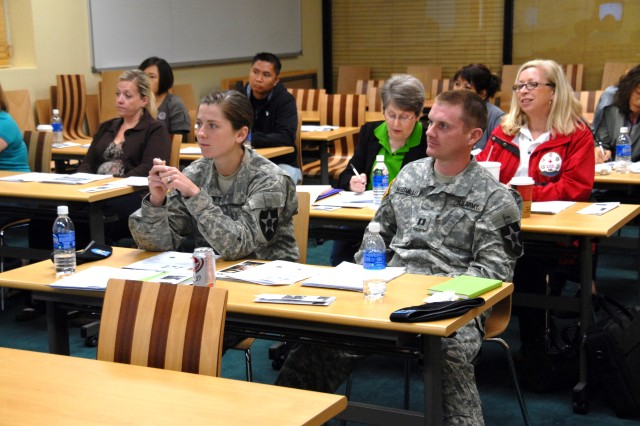 Soldiers and Family members listen intently during a class International Humanitarian Law class held by the American Red Cross Sept. 25 at the USAG-Casey Family Readiness Center. The class taught the Soldiers and Family members about the laws governing warfare and the Geneva Convention.