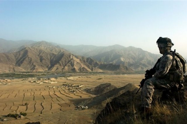 In this file photo, A Soldier from the 10th Mountain Division looks out over the village of Sarhani during a patrol, June 30. The Soldier is with 1st Battalion, 32nd Infantry Regiment, 10th Mountain Division, and his unit has been patrolling Afghanistan's volatile Kunar province since arriving in early January.