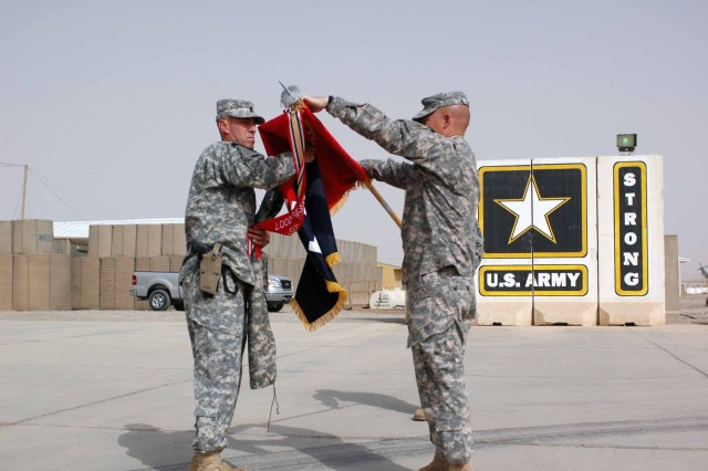 Command Sgt. Maj. Jesus Ruiz (left), Task Force Wings command sergeant major, and Col. Michael Lundy, commander, TF Wings, uncase the brigade's colors during the Transfer of Authority ceremony at Contingency Operating Base Speicher, Iraq, Oct. 10. TF Wings relieved TF Falcon of the 10th Mountain Division. (U.S. Army photo by Sgt. 1st Class Tyrone C. Marshall Jr., 25th Combat Aviation Brigade Public Affairs).