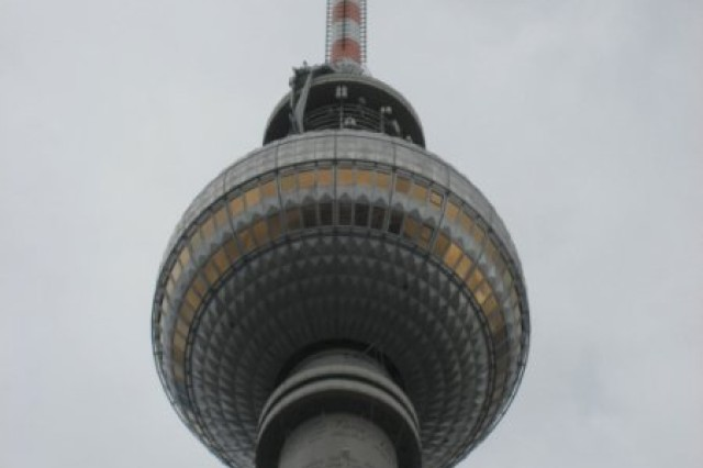 """Nicknamed """"St. Walter"""" after the architect or called """"The Pope's Revenge"""" due to a persistent reflection shaped like a cross, the Fernsehturm (TV tower) of East Berlin provides a great view of the city and features a revolving restaurant and guest viewing area at the middle of the globe.  The speed of revolutions was doubled since the author first visited in 1979."""