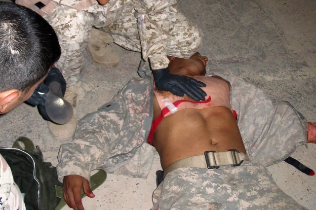 An Iraqi soldier from the 49th Iraqi army Brigade demonstrates how to treat a chest wound during a five-day combat lifesaver course at their headquarters in Kirkuk province, Iraq, late August. The training, provided by medics from 1st Battalion, 8th Cavalry Regiment, 2nd Brigade Combat Team, 1st Cavalry Division, and a Military Transition Team, not only instructed IA soldiers on advanced lifesaving skills, but will allow them to instruct other IA medics.