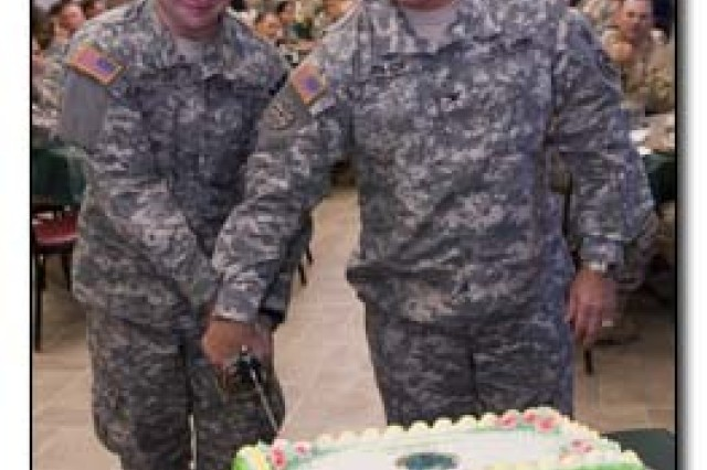 Army Pvt. John Grauer and Army Col. Bruce Vargo, commander of the Joint Detention Group, cut a cake at Joint Task Force Guantanamo in honor of the Military Police's 68th Regimental birthday, Sept. 25, 2009. The MP branch was officially recognized by the Army on Sept. 26, 1941, and is among one of the most deployed branches, trailing only the Special Forces.(JTF Guantanamo photo by Army Sgt. Andrew Hillegass)
