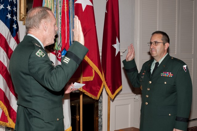 Lt. Gen. Stephen M. Speakes, Deputy Chief of Staff, G-8, administers the oath of office to Brig. Gen. Harold J. Greene, Research, Development and Engineering Command Deputy Commanding General, during his promotion ceremony held at Top of the Bay, APG on Oct. 9.