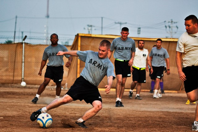 CAMP TAJI, Iraq-Players from the 615th Aviation Support Battalion and 4th Battalion, 227th Aviation Regiment, both of the 1st Air Cavalry Brigade, look on, during a scrimmage game between the two battalions, Oct.10, at Camp Taji, Iraq. The game was won 5-4 by 4-227th. Both sides used the game as preparation for the upcoming Camp Taji soccer tournament.