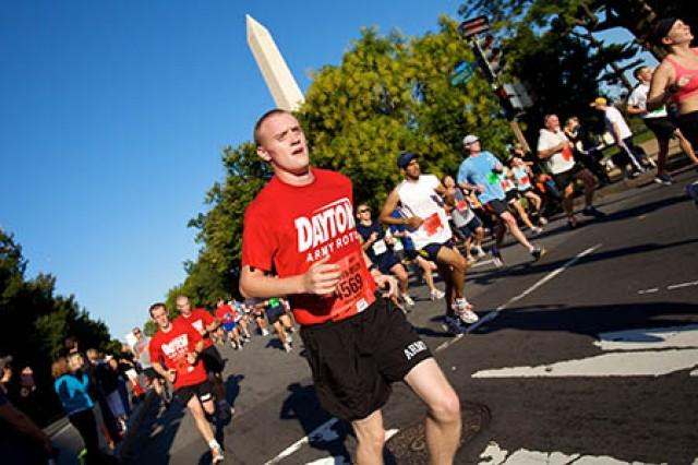 "University of Dayton (Ohio) Army ROTC Cadet James J. Maskovyak runs along Independence Ave. in Washington, D.C., near the Washington Monument and the 5-mile mark of the Army Ten-Miler Oct. 4."""