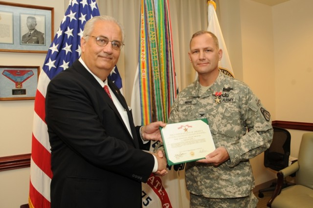 Col. David Moore, project manager of Battle Command, (right) received the Bronze Star from Mr. Dean Popps, Army acquisition executive, acting Assistant Secretary of the Army for Acquisition, Logistics and Technology, on Sept. 9 at the Pentagon.