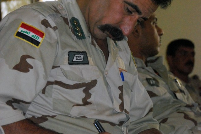 CAMP TAJI, Iraq- An Iraqi Army Sergeant Major, assigned to the 37th Brigade, 9th Iraqi Army Division, takes notes during field medical procedures classes, Oct. 10. The medical training is one of many programs the Soldiers of the 1st Battalion, 82nd Field Artillery Regiment, 1st Brigade Combat Team, 1st Cavalry Division, conduct during the week long Tiger Academy held at Camp Taji, north of Baghdad.
