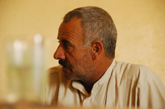 TAJI, Iraq- Sheik Abdullah, a local Sons of Iraq leader, listens during a meeting with Soldiers of the 1st Battalion, 82nd Field Artillery Regiment, 1st Brigade Combat Team, 1st Cavalry Division, Oct. 9. During the visit, Abdullah and the Americans discussed many issues concerning the people of his village.