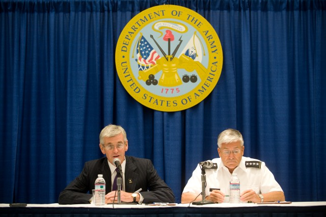 The Secretary of the Army,  John McHugh, and the Chief of Staff of the Army, Gen. George W. Casey Jr., host a press conference at the 2009 Association of the U.S. Army Annual Meeting in Washington, D.C., Oct. 5, 2009.