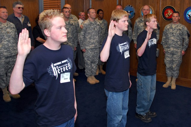 Earlier this year, triplets John Paul, Jacob Erik and Joshua Clint Temple take the oath of enlistment at the Little Rock, Ark., Military Entrance Processing Station. These three were just part of the record year, which saw the Army and other military services' active and reserve components notch record recruiting numbers and sign up the highest-quality recruits ever.