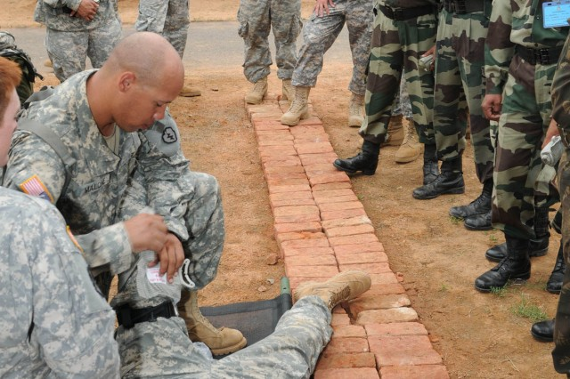 """CAMP BUNDELA, India (Oct. 12, 2009) - Sgt. Patrick Malone, C Troop, 2nd Squadron, 14th Cavalry Regiment, """"Strykehorse,"""" 2nd Stryker Brigade Combat Team, 25th Infantry Division, demonstrates how to apply the combat application tourniquet t for Indian Army medical personnel assigned to the 31st Armored Division, during a medical workshop during Exercise Yudh Abhyas 09 at Camp Bundela India, Oct. 12. YA09 is a bilateral exercise involving the Armies of India and the United States. The primary goal of the exercise is to develop and expand upon the relationship between the Indian and U.S. Army."""