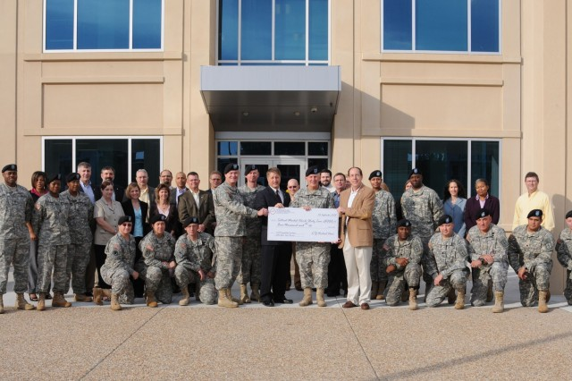 Maj. Gen. James E. Chambers, CASCOM, SCoE and Fort Lee commanding general and William Moore, deputy to the commanding general, stand with the members of CASCOM's Force Design Development Directorate after they were awarded the ARCIC Combat Developer of the Year Award for their study on Tactical Wheel Vehicle inventories.