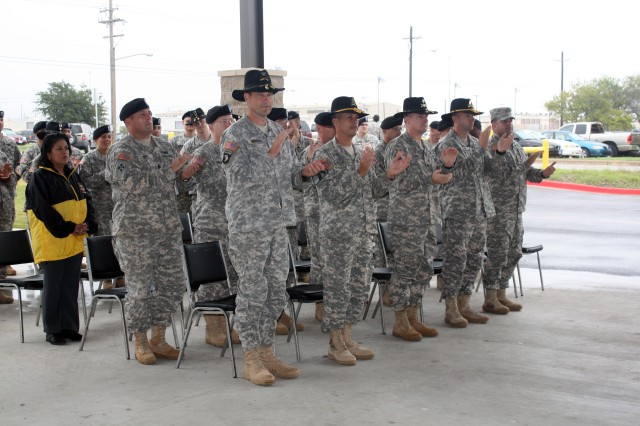 "Unit leaders, assigned to the 4th Brigade Combat Team, 1st Cavalry Division, sang the ""Army Song"" during the newly formed Co. C., 4th Brigade Special Troops Battalion, 4th Brigade Combat Team 1st Cavalry Division activation ceremony held behind the company headquarters at Fort Hood Oct. 7. The new Engineer unit is a combination of Soldiers from two battalions within the combat team."