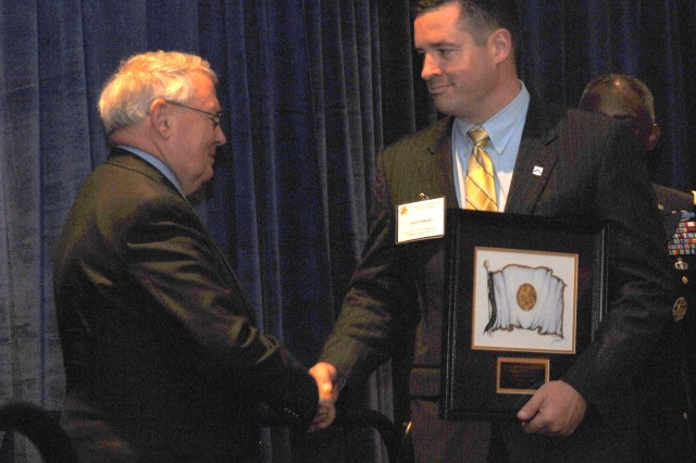 Dale Ormond, deputy to the commanding general of the U.S. Army Combined Arms Center, receives the AUSA civilian award during the AUSA Civilian Luncheon at the Renaissance Hotel in Washington D.C. on Oct. 7. (Photo by Carroll Kim)