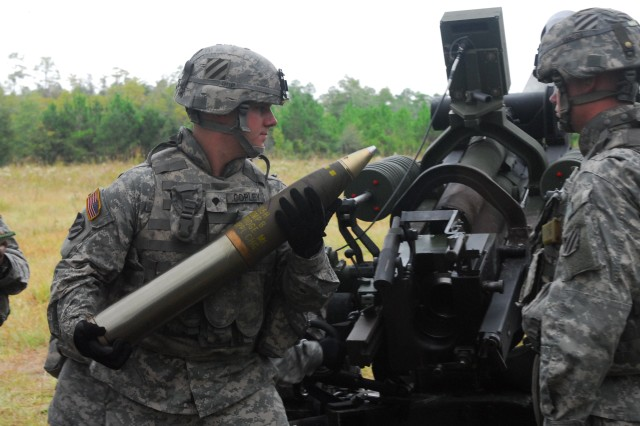 Specialist Michael Copley, Battery B, 1/76 FA, loads the M119 Howitzer during his section's qualification table at Fort Stewart, Oct. 6