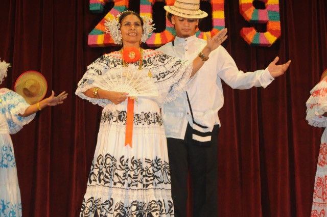 Dancers from the Hinesville Hispanic Dance Club demonstrate traditional Hispanic dances at the Hispanic Heritage celebration at Fort Stewart, Oct. 8.