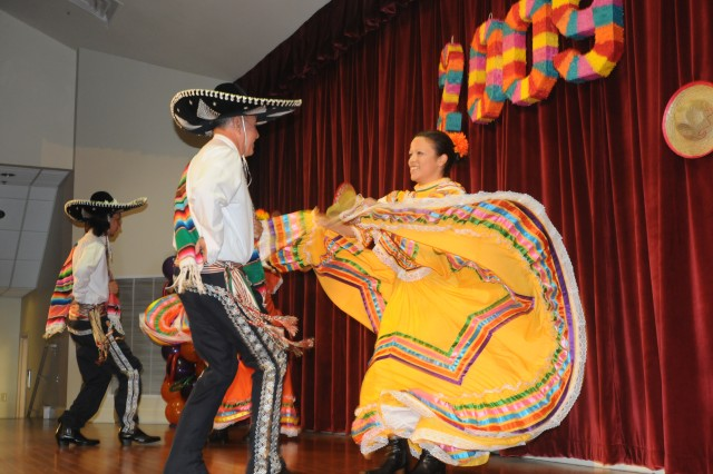 Dancers from the Hinesville Hispanic Club demonstrate dances native to Mexico during the Hispanic Heritage celebration at Fort Stewart's Main Post Chapel, Oct. 8.