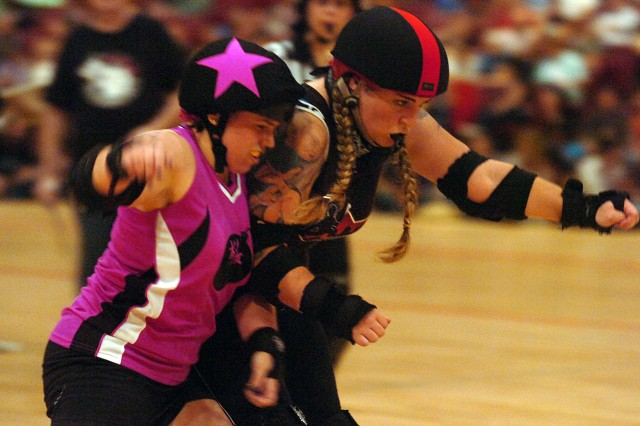 A DC Cherry Blossom Bombshell skater endures a hit during an exhibition match.
