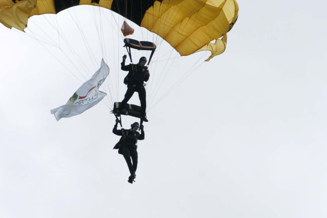 Spc. Brandie Phillips (bottom), and Staff Sgt. Brandon Valle, both members of the U.S. Army Parachute Team, the Golden Knights, perform a dual maneuver where Valle placed his feet in Phillips control lines.