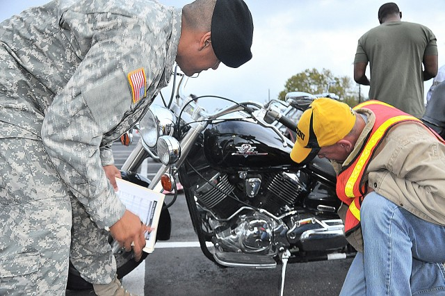 Before the ride to Fredericksburg, Texas, Soldiers assigned in groups using the T-Clocs inspection checklist, inspect a motorcycle's tires and wheels, controls, lights, oil, chassis and stands.