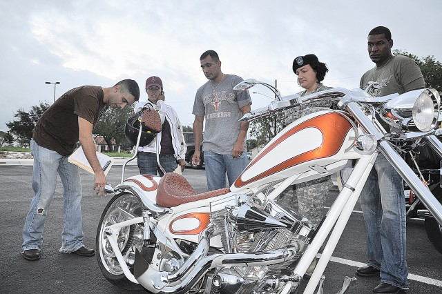 Capt. Kenneth Rodriguez, 264th Medical Battalion safety officer, inspects a motorcycle using the T-Clocs inspection checklist, the official safety checklist for the Motorcycle Safety Foundation before riding to Fredericksburg, Texas on Oct. 8.