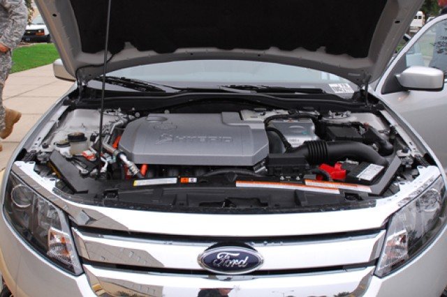 The dual-powered transmission of the hybrid electric Ford Fusion is connected to both the electric motor and the gasoline engine. The gas engine is smaller than in most vehicles, allowing the hybrid to cut down on fuel emissions.