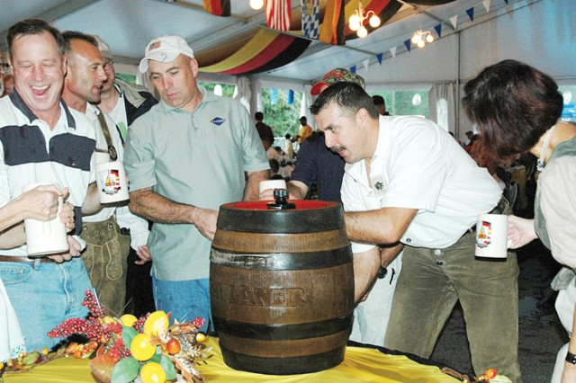 "Opening the ceremonial beer keg during the ""keg tapping"" marks the official start to Fort Benning's Oktoberfest."