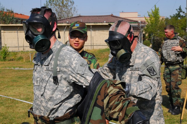 Soldiers from Headquarters and Headquarters Battery, 35th Air Defense Artillery Brigade and Airmen from the Republic of Korea Air Force conducted a combined CBRN training exercise at Osan Air Base, Korea on Oct. 9. The exercise included decontamination operations in MOPP 4.