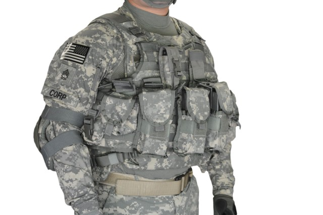 Sgt. 1st Class William Corp at PEO Soldier stests the new KDH plate-carrier vest with ammo pouches attached.