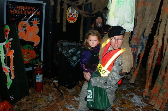 After controlling traffic, U.S. Army Staff Sgt. Adam J. Rosenlund gets time to escort his daughter, Arielle, thorugh the haunted house and other attractions during USAG Schinnen's Trunk or Treat 2008. Trunk or Treat 2009 will be as fun as ever and will be held Oct. 30, 5:30 to 7 p.m. with free bus service from the SSO from 4 to 8:30 p.m. (See map on this webpage)