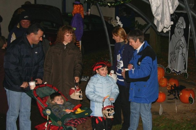Family Members and Children make the rounds from trunk-to-booth-to-tent-to-trunk in their quest for candy and fun while taking part in Trunk or Treat 2008. Trunk or Treat 2009 will be held Oct. 30, 5:30 to 7 p.m. with free bus service from the SSO from 4 to 8:30 p.m.