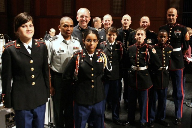 As part of The United States Army Field Band's educational outreach initiative, the Jazz Ambassadors entertained Fort Worth, Texas, area students at Bass Performance Hall. Some of the students from the Leonard Middle School Junior Reserve Officers' Training Corps (JROTC) program took time to pose alongside some of the Jazz Ambassadors prior to the concerts. The JROTC students acted provided the color guard for all three performances that day.