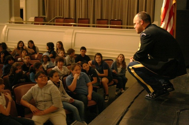 Sgt. 1st Class Andrew Layton, saxophonist with the Jazz Ambassadors, talks to audience members prior to a concert at Bass Performance Hall in Fort Worth, Texas. More than 2,000 area students came to watch America's Big Band in action.