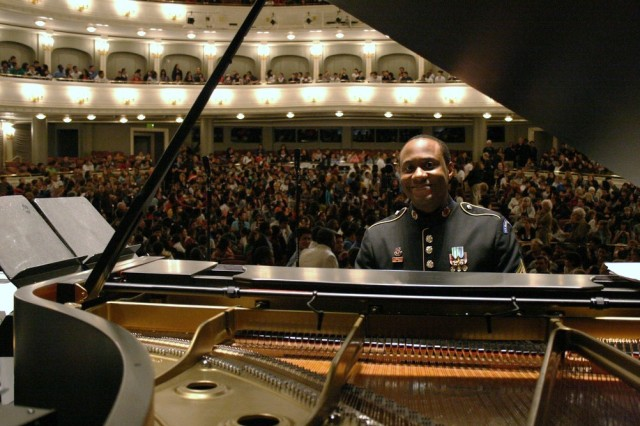 Sgt. 1st Class Tim Young smiles for the camera prior to the Jazz Ambassadors' third performance for concert goers at Bass Performance Hall in Fort Worth, Texas. America's Big Band packed the house, entertaining nearly 5,000 in the greater Fort Worth area.