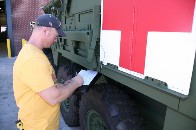 Vince Grasser inspects the Stryker MEV that was part of a special yearlong overhaul project for Anniston Army Depot and General Dynamics Land Systems.