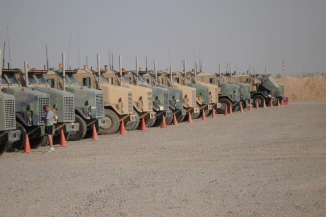 Staff Sgt. Shawn Harris, a Shreveport, La., native, with the 1083rd Transportation Company, 264th Combat Sustainment Support Battalion, checks bumper numbers on heavy equipment transport trucks prior to a mission.