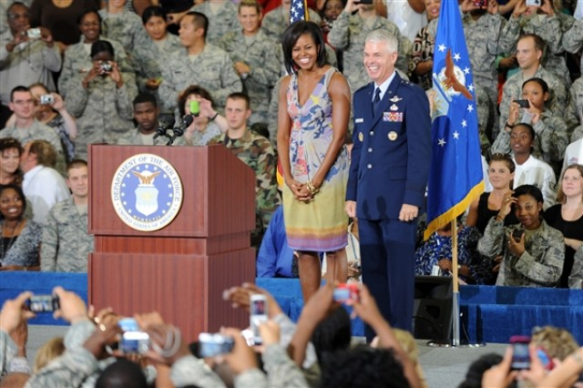 First Lady Michelle Obama and Air Force Maj. Gen. Charles R. Davis smile to the crowd before speaking on family values, Oct. 15, 2009, at Eglin Air Force Base, Fla. Davis is the commander of the Air Armament Center, Air Force Material Command at Eglin.