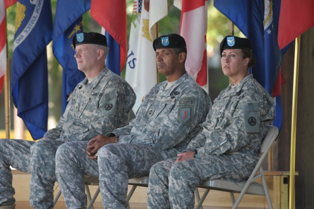 1st Infantry Division Commander, Maj. Gen. Brooks is flanked by outgoing and incoming 3rd ESC commanders Brig Gen Michael Lally (left) and Col. Promotable Robin Akin (right). ""