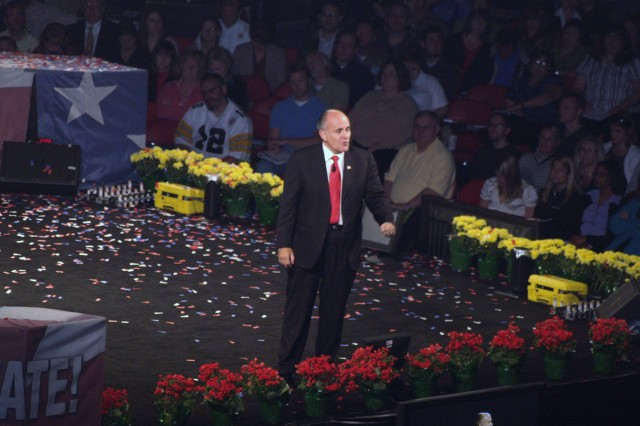 """Former New York mayor and presidential candidate, Rudy Giuliani, spoke to a crowd of nearly 17,000 during the """"Get Motivated"""" business seminar held at Louisville's Freedom Hall Tuesday, Sept. 29.  Several Soldiers from Fort Knox's 3d Sustainment Command (Expeditionary) attended the seminar which stressed leadership and self-improvement skills. (U.S. Army Photo by Spc. Michael Behlin)"""