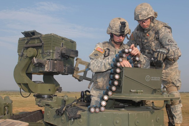 """CAMP BUNDELA, India (Oct. 15, 2009) - Spc. Timothy Cooke and Sgt. Kyle O'Leary, both assigned to Troop A, 2nd Squadron, 14th Cavalry Regiment """"Strykehorse,"""" 2nd Stryker Brigade Combat Team, 25th Infantry Division, from Schofield Barracks, Hawaii, prepare to shoot the MK 19 or Mark 19 grenade launcher during range training at Exercise Yudh Abhyas 09, Oct. 15. YA09 is a bilateral exercise involving the Armies of India and the United States."""