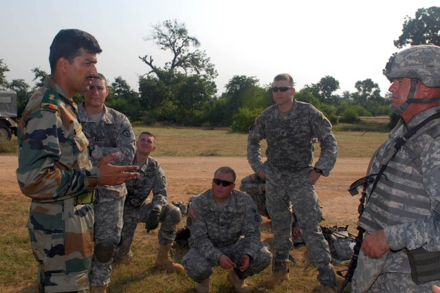 """CAMP BUNDELA, India (Oct. 14, 2009) - Indian Army Maj. Yajuvendra Singh, range officer, discusses upcoming training with 1st Sgt. Anthony Coates, senior enlisted leader of Troop C, 2nd Squadron, 14th Cavalry Regiment """"Strykehorse,"""" 2nd Stryker Brigade Combat Team, 25th Infantry Division, from Schofield Barracks, Hawaii, during Exercise Yudh Abhyas 09, Oct. 14. YA09 is a bilateral exercise involving the Armies of India and the United States."""