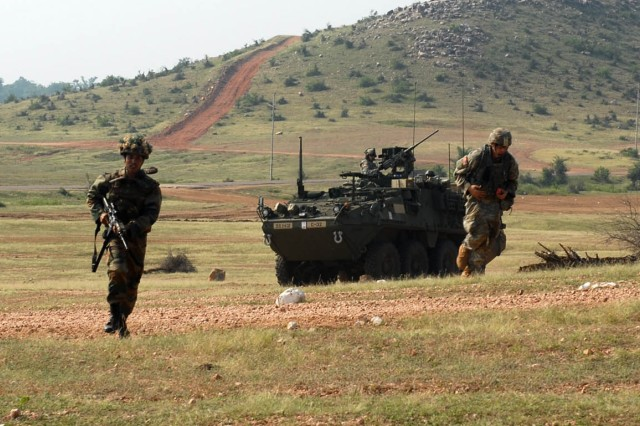 """CAMP BUNDELA, India (Oct. 15, 2009) - Indian Army Soldiers assigned to the 94th Armored Brigade along with U.S. Army Soldiers assigned to Troop C, 2nd Squadron, 14th Cavalry Regiment """"Strykehorse,"""" 2nd Stryker Brigade Combat Team, 25th Infantry Division, from Schofield Barracks, Hawaii charge the uphill range during Exercise Yudh Abhyas 09, Oct. 15. YA09 is a bilateral exercise involving the Armies of India and the United States"""