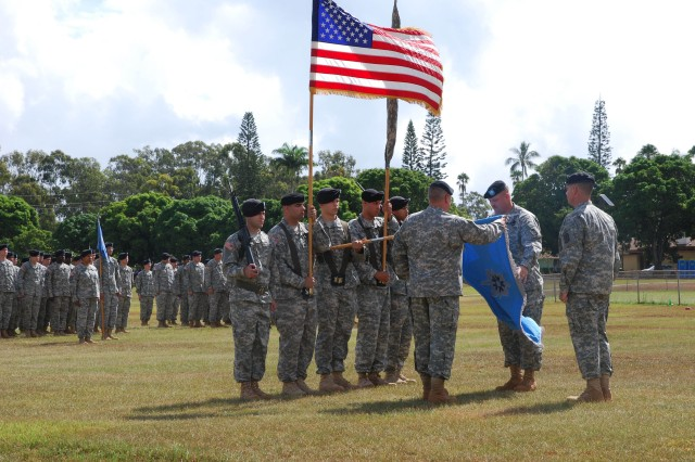 """SCHOFIELD BARRACKS, Hawaii  - From left, 732nd Military Intelligence (MI) Color Guard under the direction of Staff Sgt. Miguel Camacho; Lt. Col. Parker Pritchard, commander 715th MI Battalion; Master Sgt. Kenneth Rasmusson, 715th MI Bn.; and Col. Christopher Ballard, commander, 500th MI Brigade, unfurl the new colors of the 715th MI Bn. during a redesignation ceremony at Watt Field, Oct. 1.        The unit was previously designated as the 732nd MI Bn. The new crest with the words, """"Pacific Sentinel,"""" appear at the bottom, with a Sphinx atop, signifying the ever watchful vigilance and protection of secrets. The 732nd MI Bn. is re-designated as the 715th MI Bn., aligned under the 500th MI Bde. as part of the Theater Intelligence Brigade initiative.        Col. Christopher Ballard, commander of the 500th Military Intelligence Brigade, spoke to the assembled Soldiers, charging them to continue the important work they've been doing since the unit was designated Jan. 1, 1998.        The 715th MI Bn. is commanded by Lt. Col Parker Pritchard & Command Sgt. Maj. Dayron Vargas."""
