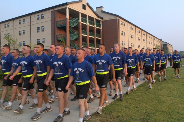 Soldiers conduct physical training outside new barracks at Fort Bragg, N.C. New barracks include suite-like living quarters for Soldiers, where bathrooms and kitchenettes are shared with only a few others. Barracks similar to these will replace Korean War-era barracks