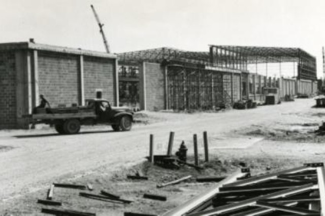 In the depotAca,!a,,cs industrial complex, Bldg. 400 at Anniston Army Depot is being constructed in 1953 to house vehicle disassembly and reassembly.