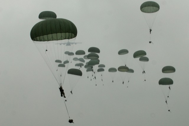 Paratroopers with B Battery, 2nd Battalion, 319th Airborne Field Artillery Regiment, 2nd Brigade Combat Team, 82nd Airborne Division, jumped onto Holland Drop Zone after a heavy drop containing a howitzer and a humvee during a mission on Oct. 14 After landing, the troopers were timed on how quickly they could pack their parachutes, get the howitzer off the pallet, assembled and ready to fire.