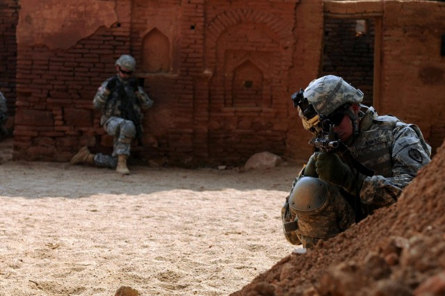 """CAMP BUNDELA, India (Oct. 16, 2009) - Pfc. Jonathan Jenkins, medic, assigned to Troop C, 2nd Squadron, 14th Cavalry Regiment, """"Strykehorse,"""" 2nd Stryker Brigade Combat Team, 25th Infantry Division, pulls security during a room clearing exercise in an 150-year-old deserted village in Babina, India, Oct. 16 as part of Exercise Yudh Abhyas. YA09 is a bilateral exercise involving the Armies of India and the United States. The primary goal of the exercise is to develop and expand upon the relationship between the Indian and U.S. Army."""