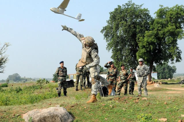 """CAMP BUNDELA, India (Oct. 16, 2009) - Spc. David Swan, infantryman, Troop B, 2nd Squadron, 14th Cavalry Regiment, """"Strykehorse,"""" 2nd Stryker Brigade Combat Team, 25th Infantry Division, tosses an Unmanned Aerial Vehicle at Babina, India Oct. 16. Strykehorse Soldiers were showing off the UAV capabilities to the Indian Army as part of Exercise Yudh Abhyas 09. YA09 is a bilateral exercise involving the Armies of India and the United States. The primary goal of the exercise is to develop and expand upon the relationship between the Indian and U.S. Army."""