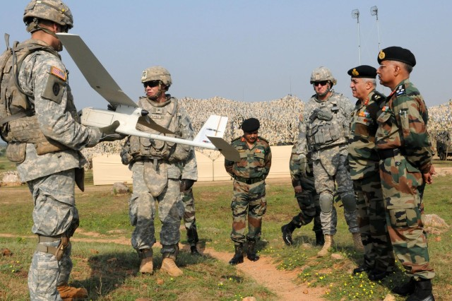 """CAMP BUNDELA, India (Oct. 16, 2009) - Sgt. Jason Couturier, cavalry scout, and Spc. David Swan, infantryman, both assigned to Troop B, 2nd Squadron, 14th Cavalry Regiment, """"Strykehorse,"""" 2nd Stryker Brigade Combat Team, 25th Infantry Division, explain how an Unmanned Aerial Vehicle operates to Indian Army Maj. Gen. Anil Malik (second from right), commander, 31st Armored Division, and Lt. Col. James Isenhower (third from right), Strykehorse commander, during Exercise Yudh Abhyas 09 in Babina India, Oct. 16. YA09 is a bilateral exercise involving the Armies of India and the United States. The primary goal of the exercise is to develop and expand upon the relationship between the Indian and U.S. Army."""